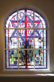 A stained glass window from within the chapel