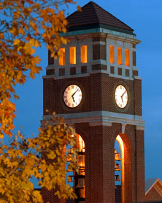 Peddle Bell Tower lit up at night pictured with autumn leaves